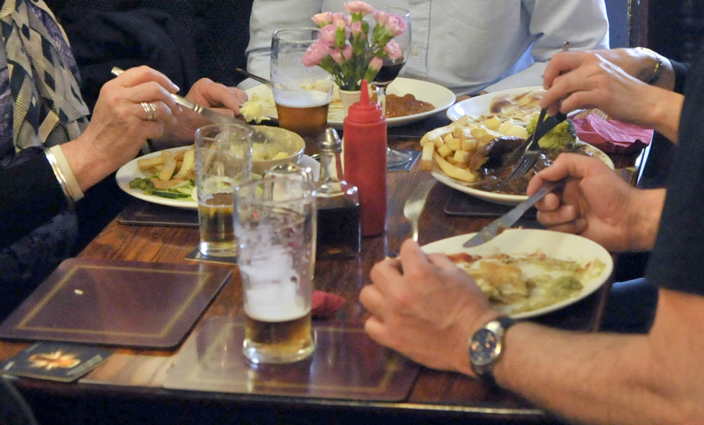 A group of people enjoying a pub meal.