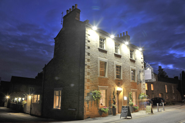 Castle Inn pub in Hornby at night.