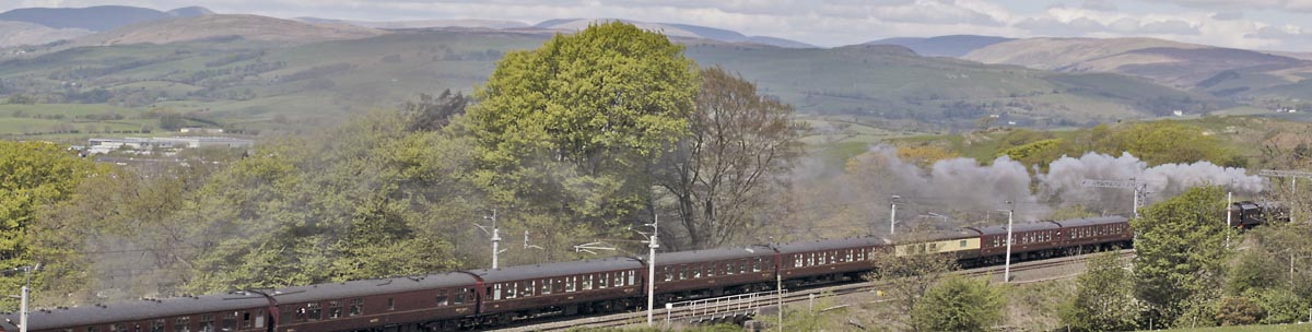 Steam train passing Kendal on the West Coast Main Line.