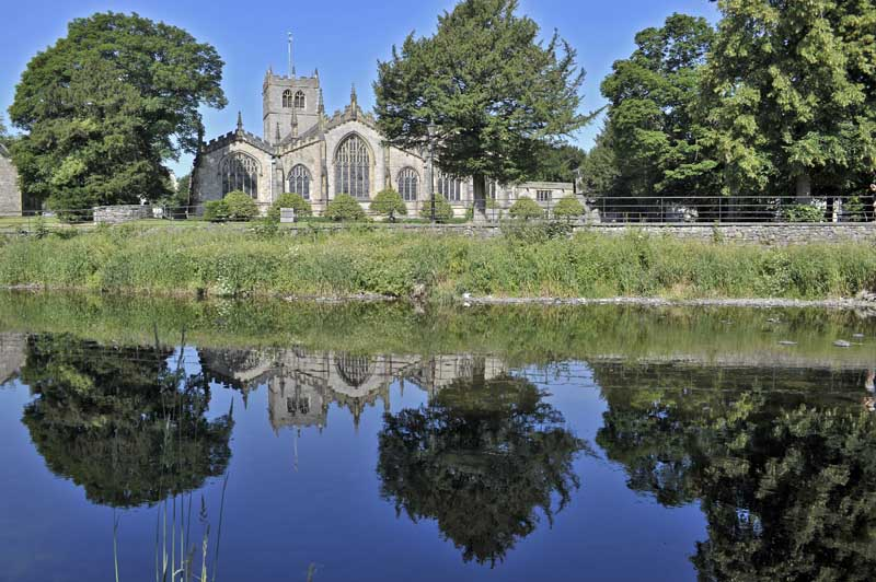 Kendal Parish Church reflected in the River Kent.
